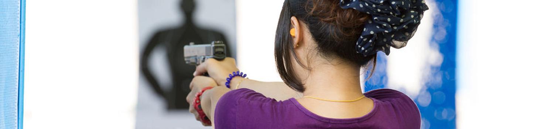 Photo of Woman Shooting at Target in a Gun Range